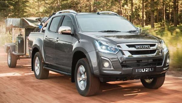 Isuzu Double Cab towing trailer on a dirt road